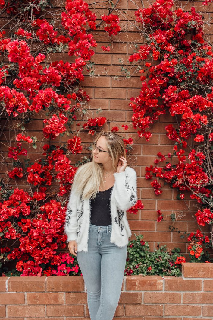 Morgan from the Morgan made photo in front of flower wall in San Francisco